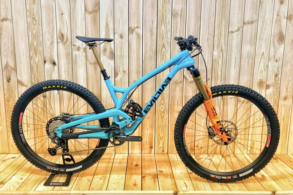 Envy Cycles shop interior with custom Evil Offering Enduro bike